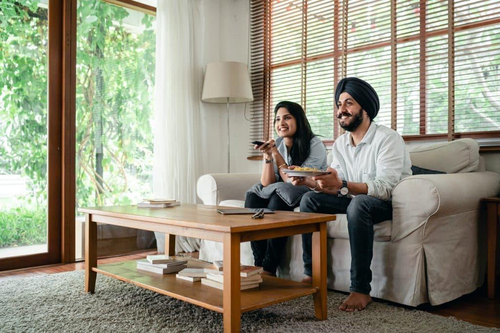 happy couple in clean toronto apartment